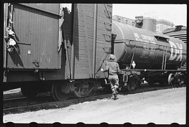 Boy hopping freight train, Dubuque, Iowa
